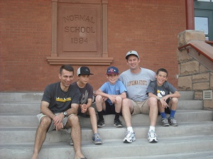 Dads and cousins on the steps at ASU